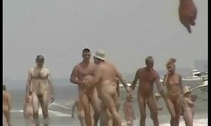 An excellent spy cam nude beach voyeur pellicle