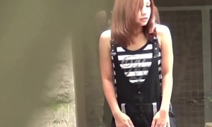 Oriental babe observed peeing
