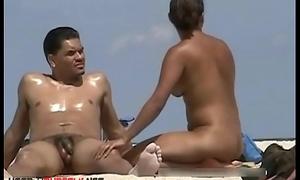 Sexy honeys filmed lounging on a nudist beach